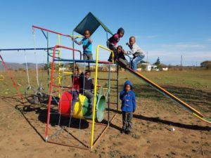 children-enjoying-a-jungle-gym-donated-and-then-erected-by-the-team